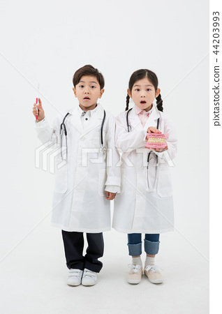 Children education. Young boy and girl wearing doctor uniform with stethoscope in white background 188 44203993