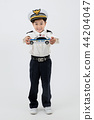 Children education. Young boy wearing police uniform in white background 174 44204047