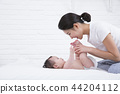 Young parents enjoying time spent with their little daughter, love and happy family concept photo 275 44204112