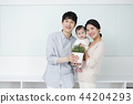 Young parents enjoying time spent with their little daughter, love and happy family concept photo 151 44204293