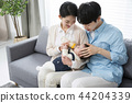 Young parents enjoying time spent with their little daughter, love and happy family concept photo 082 44204339