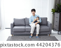 Young parents enjoying time spent with their little daughter, love and happy family concept photo 101 44204376