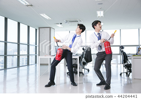 A day of young businessman in the office 159 44204441