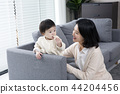 Young parents enjoying time spent with their little daughter, love and happy family concept photo 030 44204456