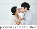 Young parents enjoying time spent with their little daughter, love and happy family concept photo 143 44204644