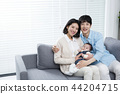 Young parents enjoying time spent with their little daughter, love and happy family concept photo 070 44204715