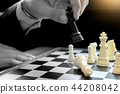 Businessman play chess use King  44208042