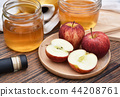 Apple cider vinegar on wooden board, Kombucha. 44208761