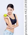 Portrait asian woman holding green apple fruit 44210430