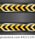 Under construction background. Black yellow stripes on metal perforated texture 44211145