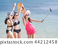 Friends taking selfie at beach on summer vacation. 44212458