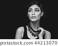 beautiful girl with hairdo on balck background 44213070