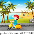 the boy driving the motorcycle on the road  44213382