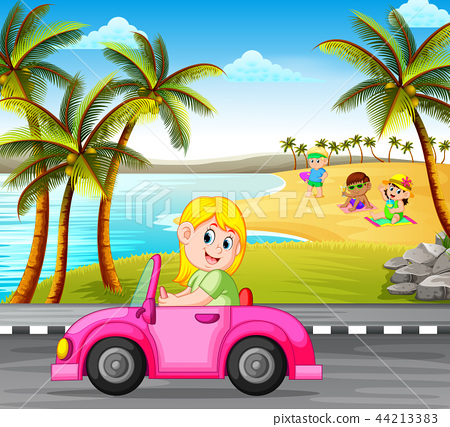 the woman drives the pink car on the street  44213383