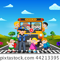 the children cross the road while the police stop  44213395
