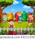 the children clean the garden and throw the trash  44213396
