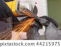 Cuts metal with a cutting machine. Close-up view 44215975