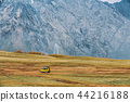 Yellow SUV Car On Off Road In Spring Mountains Landscape. Drive  44216188
