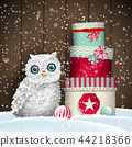 Cute white owl with stack of colorful christmas 44218366