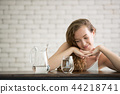 Young woman in joyful postures with jug and glass 44218741