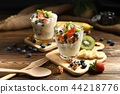 Yogurt with granola and fruits in glass 44218776