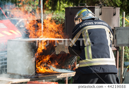 french fireman showing how to extinguish a fire 44219088