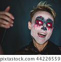 A girl makes selfie in makeup for Halloween. 44226559
