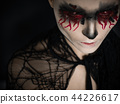 Portrait of a female vampire over black background 44226617