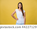 Portrait of young teenage girl with healthy skin wearing striped top looking at camera. Caucasian 44227129