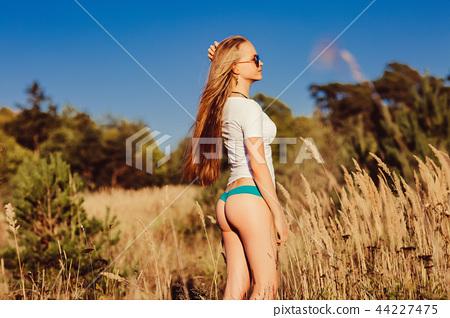 fitness blonde girl in nature in panties 44227475