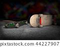 Two skateboards lying on concrete floor 44227907