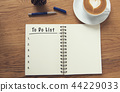 Coffee cup and notebook with to do list on rustic  44229033