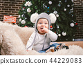 Subject children christmas new year. Caucasian little funny baby boy 1 year old sitting sleigh bear 44229083