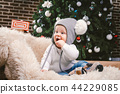 Subject children christmas new year. Caucasian little funny baby boy 1 year old sitting sleigh bear 44229085
