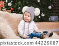 Subject children christmas new year. Caucasian little funny baby boy 1 year old sitting sleigh bear 44229087