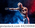 Muscular topless fighter in boxing gloves 44230068