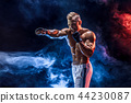 Muscular topless fighter in boxing gloves 44230087