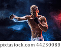 Muscular topless fighter in boxing gloves 44230089