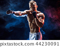 Muscular topless fighter in boxing gloves 44230091