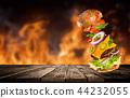 Big tasty burger with flying ingredients. 44232055