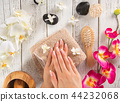 Woman with beautiful manicured nails. 44232068