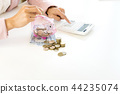 Business man woman hold collect coin in the row in 44235074