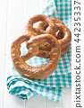 Tasty salted pretzels. 44235337