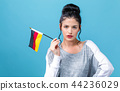 Young woman with a German flag 44236029