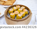 Shrimp yellow dumplings. Dim sum set. in bamboo 44236326