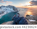 Man hiker cross legs sitting on peak mountain 44236624
