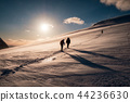 Climbers with backpack climbing on snowy mountain 44236630
