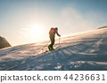 Man skier with backpack trekking on snow mountain 44236631