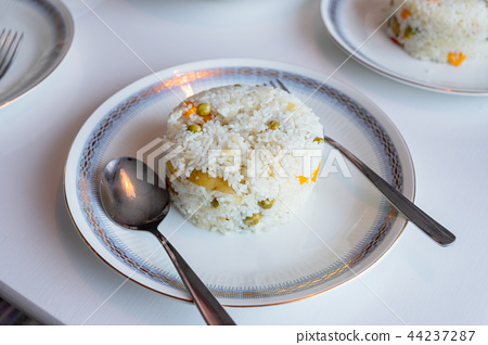 Jasmine rice mixed with potato and peas 44237287