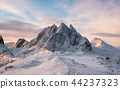 Majestic mountain range with snowfall at sunrise 44237323